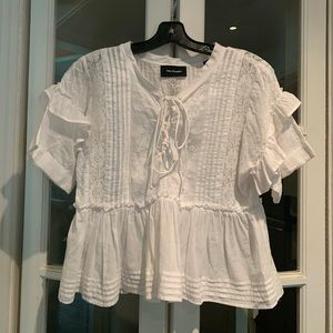 The Kooples white lace-up short sleeve top.Size XS